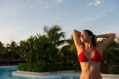 Relaxed woman enjoying summer vacation at caribbean resort Royalty Free Stock Photography