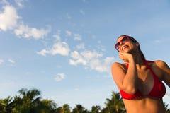 Relaxed woman enjoying summer vacation at caribbean resort Royalty Free Stock Photo