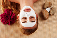 Relaxed woman with a face mask Stock Photo