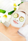 Relaxed woman with a facial mask Royalty Free Stock Photography