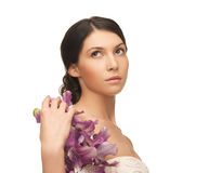 Relaxed woman with flowers Stock Images