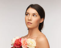 Relaxed woman with flowers Royalty Free Stock Photo