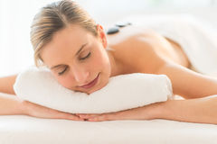 Relaxed Woman Getting Hot Stone Therapy At Spa Stock Photos