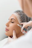Relaxed woman getting hyaluronic acid injection Royalty Free Stock Image