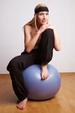 Relaxed woman in gym ball Stock Images