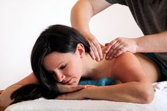 Relaxed woman with hand massage at beauty spa center royalty free stock photography
