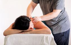 Relaxed woman with hand massage at beauty spa center stock photo