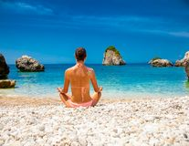 Relaxed woman has a meditation on a beach. Greece. Royalty Free Stock Images