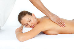 Relaxed woman having a back massage Royalty Free Stock Images