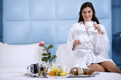 Relaxed Woman Having Breakfast in Bed Stock Photos