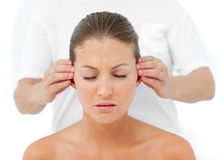 Relaxed woman having a head massage Royalty Free Stock Image