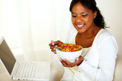 Relaxed woman having healthy breakfast Stock Photography