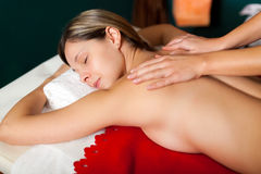 Relaxed woman having a massage Royalty Free Stock Photography