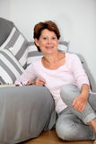 Relaxed woman at home Stock Photos