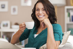 Relaxed woman at home Royalty Free Stock Photos