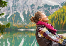Relaxed woman on lake braies in south tyrol Stock Photography