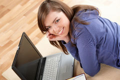 Relaxed woman with laptop Stock Images