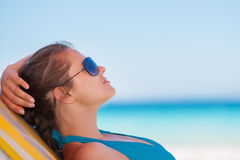 Relaxed woman laying on beach Royalty Free Stock Photo