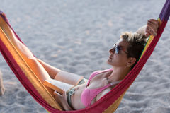 Relaxed woman laying in hammock Royalty Free Stock Image