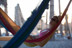 Relaxed woman laying in hammock Royalty Free Stock Images