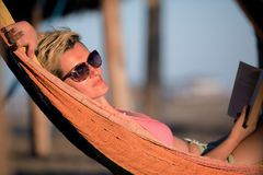 Relaxed woman laying in hammock Stock Image