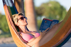 Relaxed woman laying in hammock Stock Photo