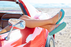 Relaxed woman legs in a car window on the beach Royalty Free Stock Photo
