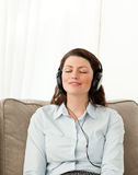 Relaxed woman listening music with headphones Royalty Free Stock Photos