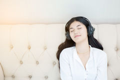 Relaxed woman listening  music Royalty Free Stock Photos