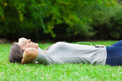 Relaxed woman listening music Royalty Free Stock Photo