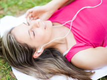 Relaxed woman listening music Royalty Free Stock Image
