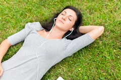 Relaxed woman listening music Stock Images