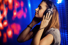 Relaxed woman listening to music Stock Image