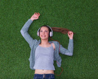 Relaxed woman listening to the music with Royalty Free Stock Image