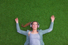 Relaxed woman listening to the music with Royalty Free Stock Images