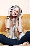 Relaxed woman listening to music in the living-room at home Royalty Free Stock Photo