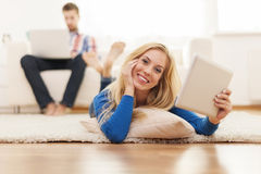 Relaxed woman in living room Royalty Free Stock Photography