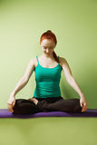 Relaxed woman in lotus pose Royalty Free Stock Photos