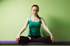 Relaxed woman in lotus position Royalty Free Stock Image