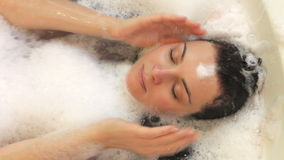 Relaxed woman lying in bubble stock video