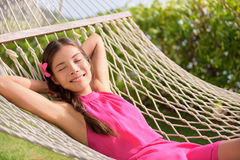 Relaxed Woman Lying On Hammock In Park Stock Images