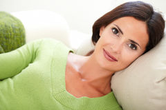 Relaxed woman lying on her back Royalty Free Stock Image