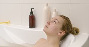 Bathing woman rest stock video