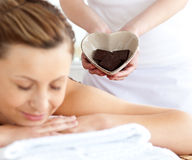 Relaxed woman lying on a massage table Stock Photography