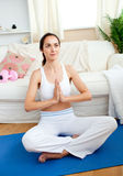 Relaxed woman meditating in her living-room Royalty Free Stock Photo