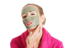 Relaxed woman with a nourishing face mask Stock Photos