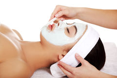 Relaxed woman with a nourishing face mask Stock Image