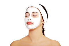 Relaxed woman with a nourishing face mask Royalty Free Stock Photography