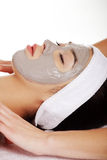 Relaxed woman with a nourishing face mask Royalty Free Stock Image