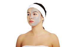 Relaxed woman with a nourishing face mask Royalty Free Stock Photos